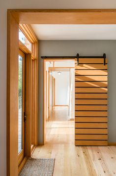 This sliding wood barn door separates a couple of bedrooms from the rest of the house.