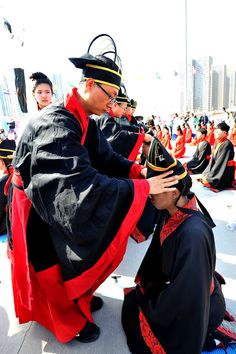 A boy receives his crown during the traditional coming of age ceremony sponsored by China Yellow River Television. This event was held during the 2nd Annual Shanxi Radio and TV Carnival.