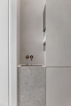 Washbasin and storage in Penthouse Westkaai by Hans Verstuyft Architects | Photo by Dorothee Dubois of The Fresh Light
