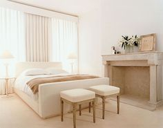 Reed Krakoff's New York brownstone shows off the minimalist appeal of winter whites—further evidenced by the guest bed, which was designed by his wife, Delphine.