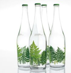 """Designed by Pati Nunez Associats   Country: Spain  """"Aguas de Fuensanta commisioned us a series of designes to be printed on 75cl glass bottles.  The aim is to place Fuensanta in the world of designer waters and to reach more 'chic' commerces.  Fuensanta's origin is linked to nature and this is what we wanted to transmit, so we tried to imitate mother nature's way and imagined what would happen to a glass bottle if we left it in a green forest: vegetation would wrap itself around the bottle."""""""