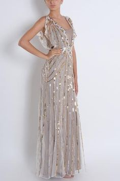 Temperley London Sequin Gown: A decadent choice - this Sequin Gown by Temperley will ensure you are oozing ultimate glamour at your next red carpet event. The short cascade sleeved and flattering silhouette make this an impeccable creation.