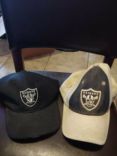 e990d2f54b9 two Oakland Raiders baseball style hats different versions.  fashion   clothing  shoes