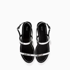 Image 2 of FLAT SANDALS WITH METALLIC STRAPS from Zara