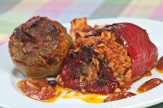 Peppers and tomatos stuffed with rice