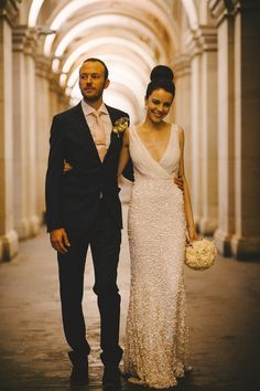 Incredible beaded column wedding dress and high bun