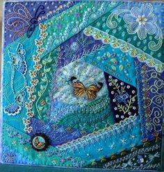 I ❤ crazy quilting & embroidery . . . Binder cover: I received a surprise package in the mail one day with a lovely butterfly silkie & some green satin. It inspired me to make a butterfly garden CQ block, from which I made a cover for the 3 ring binder that holds my print outs of CQ information. ~By Marilyn Nepper