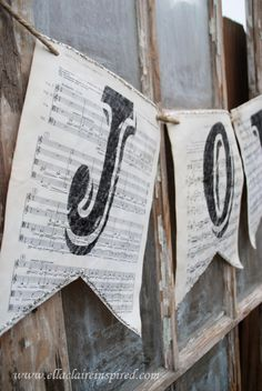 We could even do something like this with graph paper, sheet music, score cards?, paintings or prints, etc... for TTT - Vintage Sheet Music Christmas Banners Glass Glitter and Jute