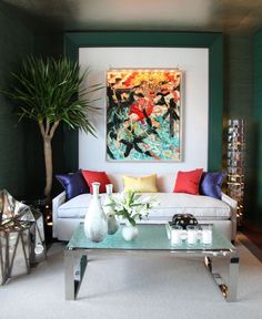 Jamie Drake - Kips Bay, color brings this living space to life using pillows and large wall art.