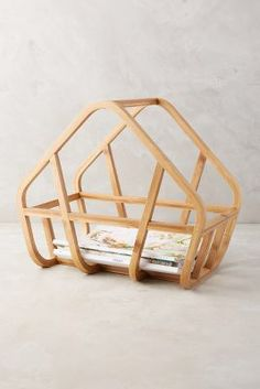 Anthropologie Bamboo Magazine Rack https://www.anthropologie.com/shop/bamboo-magazine-rack?cm_mmc=userselection-_-product-_-share-_-39580295