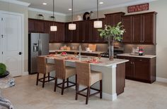Dark cabinets and light granite countertops are an on-trend home design pairing. Complete with Progress Lighting Clayton pendants Light Granite Countertops, Kitchen Countertops, Kitchen Shop, New Kitchen, Progress Lighting, Dark Cabinets, Florida Home, Kitchen Lighting, Lighting Design