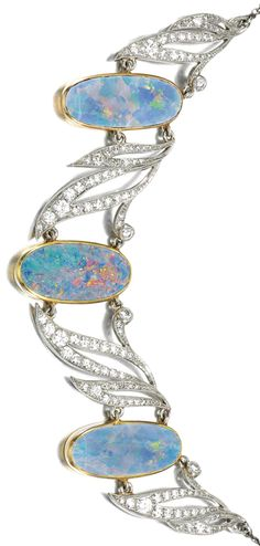 OPAL AND DIAMOND NECKLACE, A. TILLANDER, FIRST HALF OF THE 20TH CENTURY Set to the front with three oval opals between open work stylised leaves millegrain-set with circular- and single-cut diamonds, to a fine curb link chain, the clasp similarly set, inscribed to the reverse Raia 1955, length approximately 457mm, signed A.Tillander, cased.