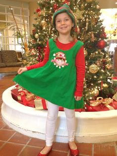 She refused to wear the polka dot tights that match the fabric on the elf cap.  Still, cute.
