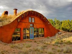 I bet hippies are inside! LOVE IT. sustainable home in the desert. off the grid and off the chaaain.