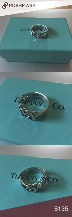 Tiffany and Co. Paloma Picasso heart ring Tiffany and Co. Paloma Picasso heart ring. Sterling silver, authentic, hardly no wear at all. Do dents or deep scratches. Size 7. Please see photos for engraving of authenticity. No longer sold in stores. Comes with box only (lost the pouch). Tiffany & Co. Jewelry Rings