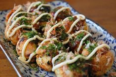 Takoyaki (たこ焼き or 蛸焼, literally fried or grilled octopus)