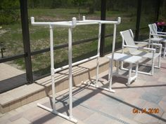 PVC rack for floaties.  would add hooks on the ends for towels