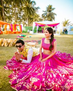 6 Non-Cheesy Ways To Coordinate Bride & Groom Outfits! – UrbanClap Sponsored Sponsored 6 Non-Cheesy Ways To Coordinate Bride & Mehndi Outfit, Pink Lehenga, Bridal Lehenga, Bollywood Lehenga, Saree, Bollywood Style, Bridal Mehndi, Indian Bride And Groom, Bride Groom