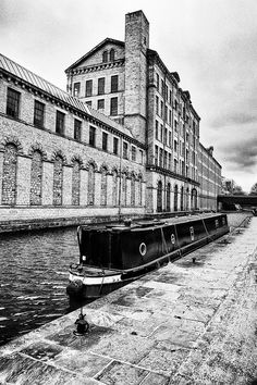 Salts Mill, Saltaire, between the Aire & Leeds Liverpool Canal. Opened in 1853 - the largest industrial building in the world.Photo by Shaun Taylor Great Places, Beautiful Places, Leeds England, Industrial Architecture, Canal Boat, West Yorkshire, Urban Photography, British Isles, Old Photos