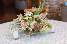 Lush florals from Chestnut and Vine on a geometric linen for cocktail hour!  Photo by Meg Perotti.