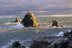 """This pair of small sea rocks has been """"wed"""" using rope and ancient Shinto tradition, Meoto Iwa, Ise, Japan"""