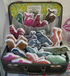 Here's how I take and display my block print stuffies when I'm at a show! It happens to be my grandma's suitcase with some wallpaper squares for extra pizazz! They are right at home all comfy and cozy on the way to their new homes!