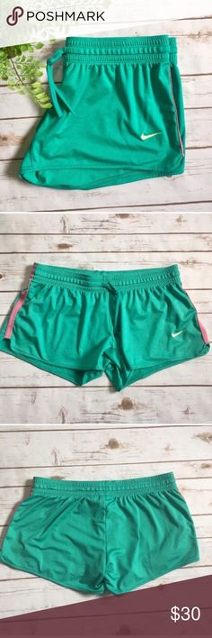 Nike Dri-Fit Mint Green Athletic Shorts  Nike Dri-Fit athletic shorts in mint green and pink color! Shorts are size L. Fabric content is 82% Polyester and 18% spandex. Great for Spring workouts! Nike Shorts