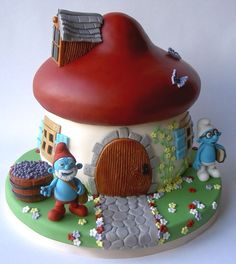 This spectacular Smurfs Cake features Papa Smurf and Brainy Smurf.