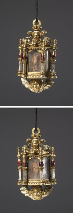 Lantern-shaped pendant reliquary; gold; middle formed of hexagonal tube of rock crystal enclosing minute wood-carving of the Ecce Homo and Crucifixion with Mary Magdalene and St John; column at each angle, lower part square, white enamel, upper baluster-shaped, ruby enamel; finial at top with double-faced head supported by two pairs of volute brackets; bottom plate engraved with strapwork panels and enamelled, projecting cherub in full relief. late 16th-early 17th century, Spain or Mexico