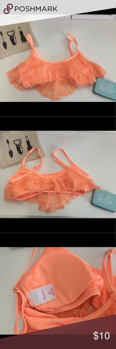 Lace Bikini Top Love this peachy color. This bikini is extremely comfortable and you do not need to worry about tying or clipping in the back. Xhilaration Swim Bikinis