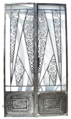 French Art Deco Wrought Iron Doors with matching Transom In the manner of Paul Kiss.  Circa 1920's, France