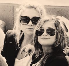 Ashley and Mary Kate Olsen...love them. thought i was their long lost triplet growing up. <3