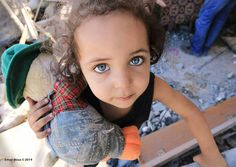 Palestinian girl in Gaza and her teddy bear. Her family home was destroyed by Israel, who murdered over 500 children in July and August  2014