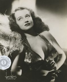 """Betty 'Blue Eyes' Howard: vintage 8x10 photo Betty began her career as a chorus girl at the Trocadero Theater in Philadelphia, PA.She danced at the President-Follies in San Francisco & by the mid to late 1940s she was a headliner on the popular burlesque circuits. On 25 January 1946 she married KRNT radio announcer Carter Reynolds. Betty was billed as """"Blue Eyes"""" or w/the tag line """"You'll LOVE her Blue eyes"""". Her gimmick, as she disrobed, was that her pasties were shaped like 2 big blue…"""