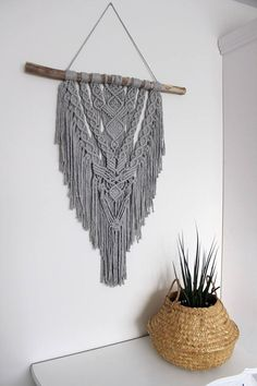 This unique piece is made by hand using grey dyed cotton rope. The used wood is a treebranche found on the Nordseacoast of the Netherlands and its surrounded dunes/forest area. The branch is cleaned and sanded where needed. Macrame wall hanging La Bohème Handmade Grey 5mm twined cotton
