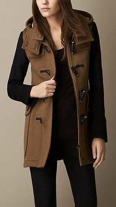 Burberry coat for $1250.00 Canadian.  The black sleeves make this have a laid back feel. More suited for the younger target market.