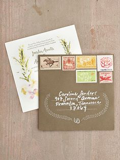 Beautiful invitations with vintage postage: LOVE!
