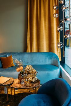 The Cara sofa and armchair paired up the Orb Pendant and gold accessories. Gold Accessories, Scandinavian Design, Cosy, Armchair, Environment, Pendant, Store, Furniture, Home Decor