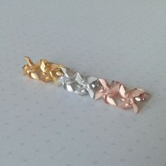 Windmill/Pinwheel Stud Earrings in yellow gold, silver and rose gold. Alice Barnes Jewellery