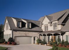 Amarr Long Panel garage door in Sandtone.  Available in Olympus, Heritage™, Lincoln, and Stratford® Collections. Visit www.amarr.com for more great styles.