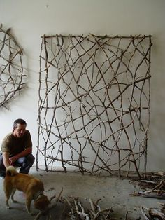 stick art! this would be cool on an outside wall of a shed....