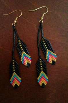Beaded Feather Earrings. #beadwork via Etsy.