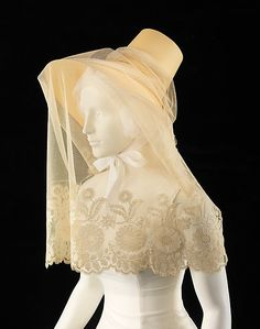 Veil Date: ca. 1830 Culture: British Medium: silk Dimensions: 37 in. (94 cm) Hat veils like this were worn both to partially conceal the face modestly and also off the face, around the hat, to decorate it, as well as to facilitate flirtatious glances.