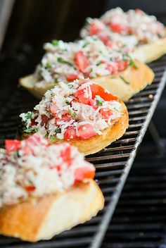 Bruschetta on the grill and OH so yummy!  One of our go-to summer recipes and easy peasy to boot!