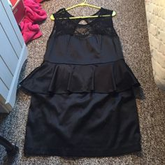peplum formal dress black, peplum style formal dress. Fitting at the bottom. lace design at top. Worn once to a wedding Black Poppy Dresses Midi