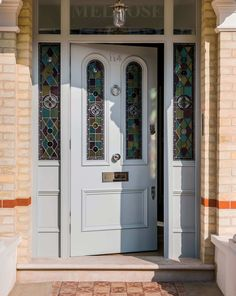 Extra thick Victorian glass door and doorframe with stained glass arches and chrome door furniture. A great example of a non-standard size Victorian front door. Craftsman Style Front Doors, Cottage Front Doors, Victorian Front Doors, Grey Front Doors, Porch Doors, Front Doors With Windows, Wooden Front Doors, House Front Door, Glass Front Door