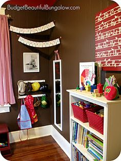 Adorable kids 'nook'- i love the shelves, dress up mirror, toy storage, and decorations to tie it all together as a fun and functional space.