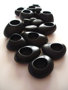 Set of 12 Glacial Stone Candle Holders - Don't these just look gorgeous? So smooth, and they'll just sit in your hand till you're ready to pop a candle in them and light it.