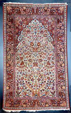 Persian 'Tree of Life' Kashan wool rug used as prayer rug, early 20th c