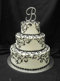 Elegant black scrollwork wedding cake